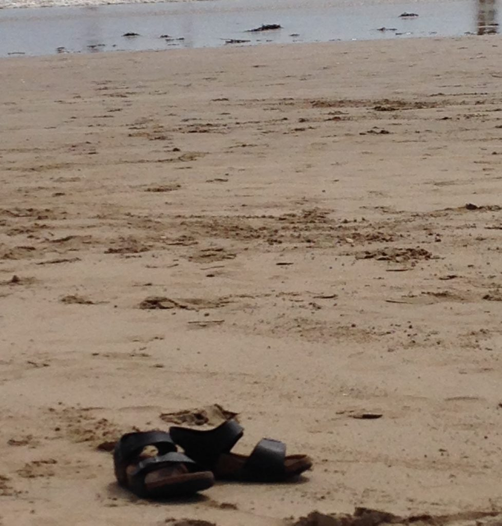 child-shoes-on-the-beach